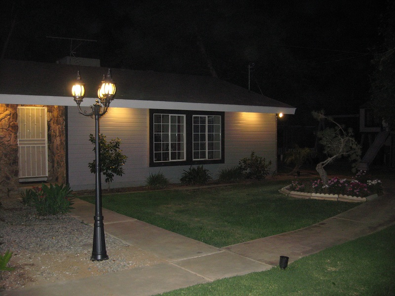 A new pole light with three CFL's installed